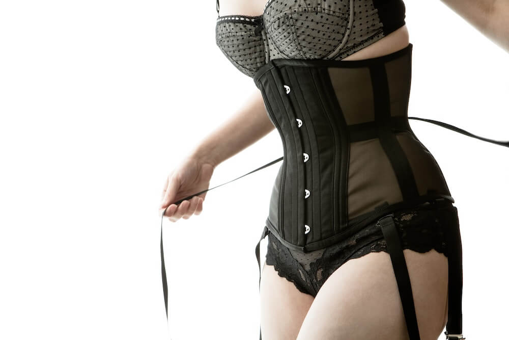 Don't be afraid to lace up and cinch down!  Model: Victoria Dagger; Photo: Joel Aron; Corset: Dark Garden.