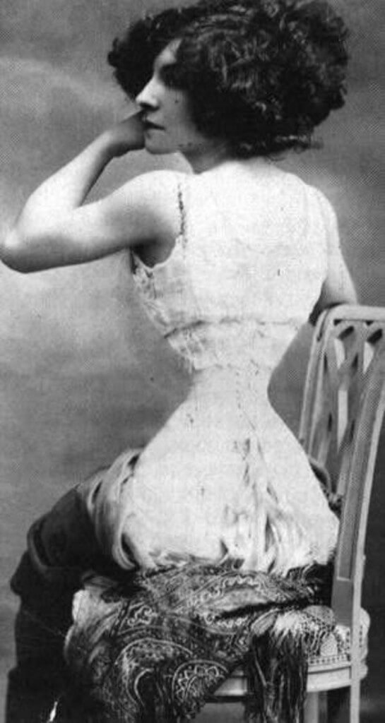 Photograph of famous tightlacing icon Polaire.  (Look a little closer to see how this photo was retouched to make her waist look more extreme.)