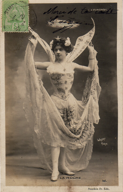Costumed dancer (?) on postcard, circa 1905. Via les2a on DeviantArt.