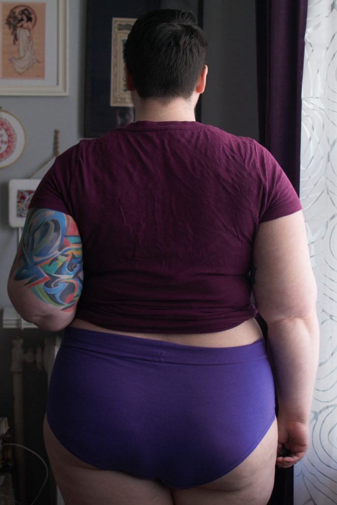 Back view of model wearing Classics brief in purple. Soft cotton fabric.