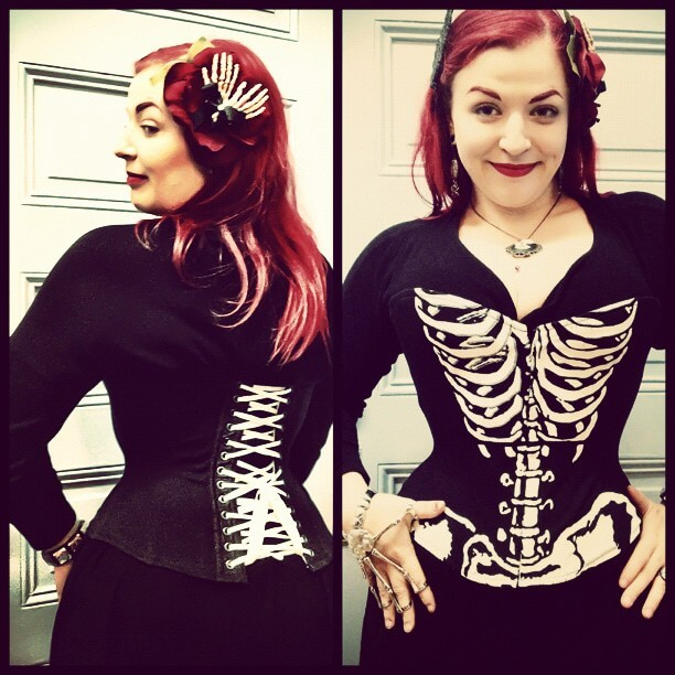 Corset by Pop Antique featuring unusual construction and a custom screen print, on makeup artist/client Chrysalis Rose. Such design innovations are easier, yet more expensive, to implement in small-scale production.