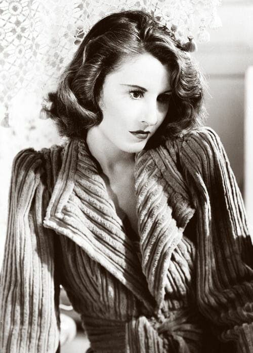 Barbara Stanwyck in a chenille robe for Remember the Night (1940)