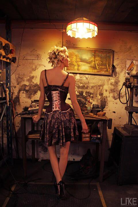 Corsets worn over clothing may not need to be worn with a modesty panel. | Photo © Jesse Alford | Model: Sara Cecil | Corset & Dress: Pop Antique