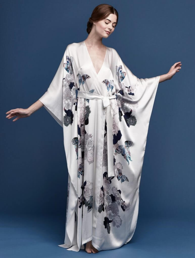 Meng. Lingerie Trends - Luxury Loungewear. Pearl colored silk kimono style robe with floral butterly print.