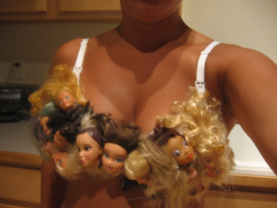 848ed60a7548e What can be creepier than severed doll heads detached from their bodies   How about when they ve been glued on to a bra and worn out in public