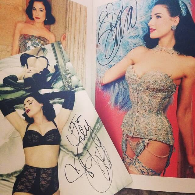 Dita was very gracious about signing multiple items for fans.  Photo by Lily Liqueur.