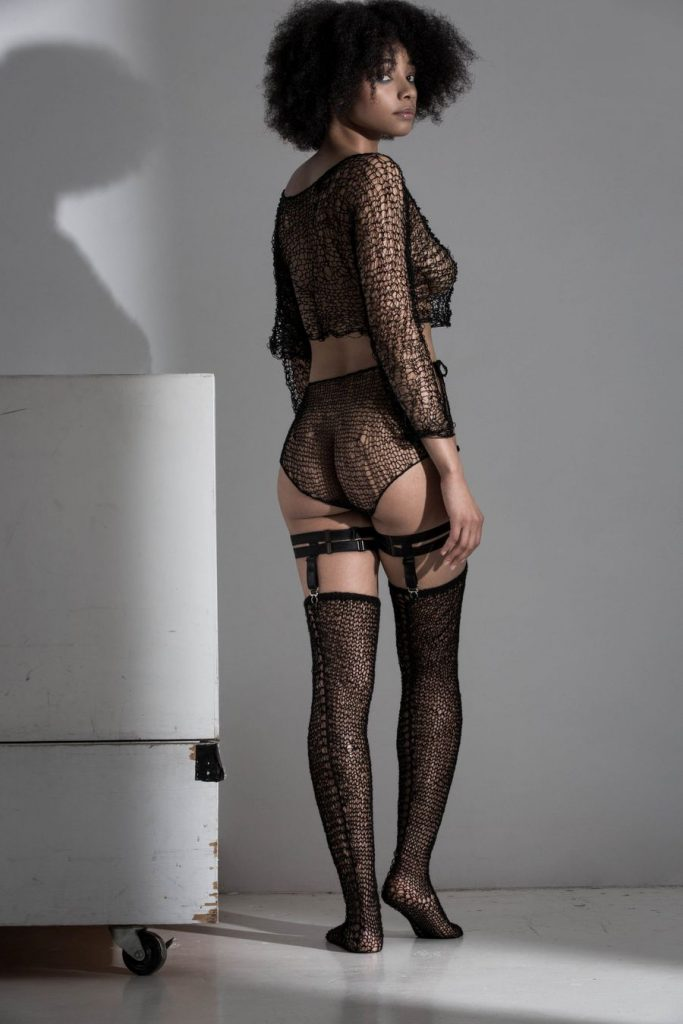 Maude Nibelungen black, sheer hand-knit lingerie set with garters and stockings. Long sleeve, knit, half top, cover up and high waist knickers.