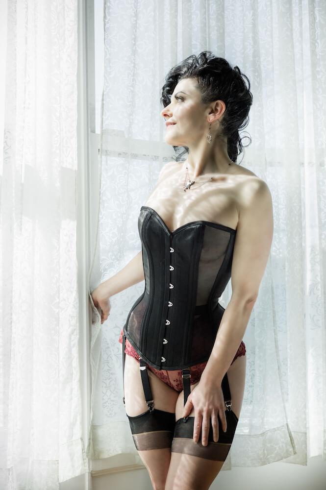 "Dark Garden proprietress Autumn Adamme in a ""Risqué"" sheer Sweetheart corset. Autumn made her first sheer corset in 2000. Photo © Joel Aron."