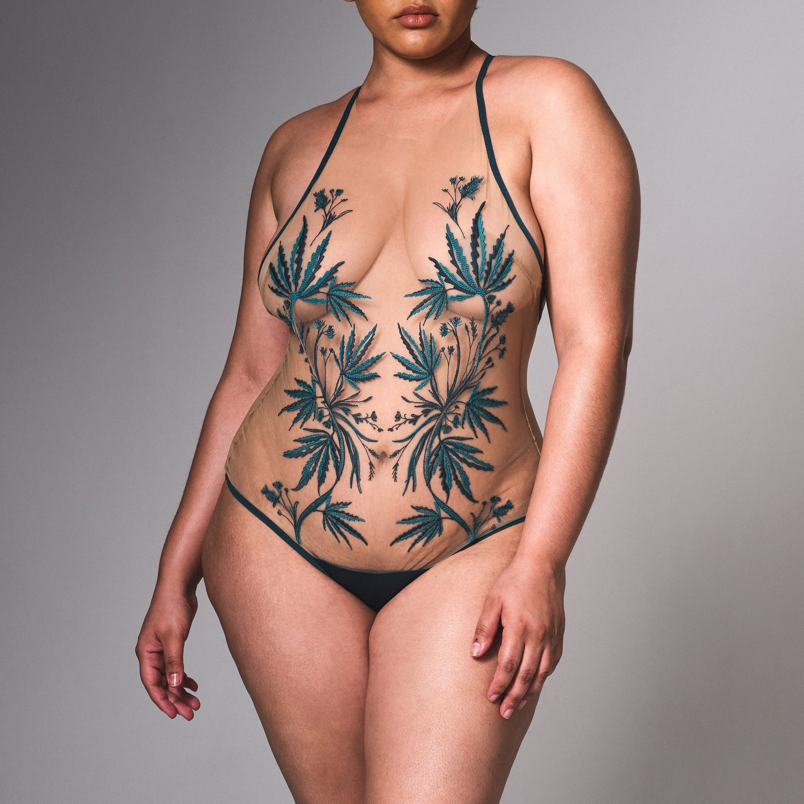 """Thistle & Spire's """"Brooklyn Haze"""" bodysuit features a fashionable take on cannabis with lush teal embroidery"""
