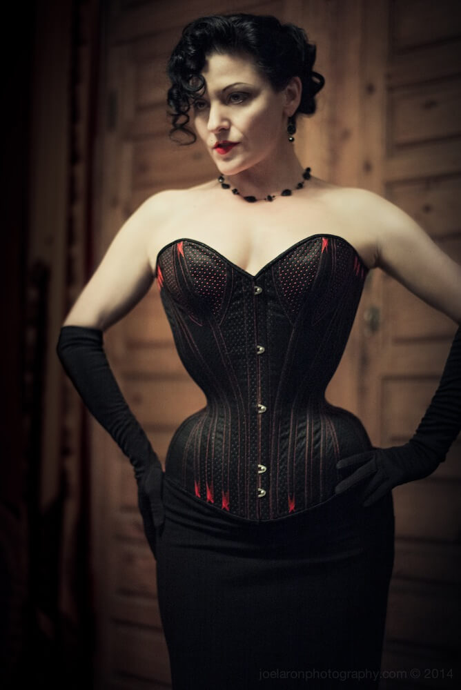 "Dark Garden ""Pearl"" corset, modeled by proprietress Autumn Adamme. This bespoke piece was created by Autumn under the tutelage of corsetry legend Mr. Pearl, and features a short pipe-stem waist. 