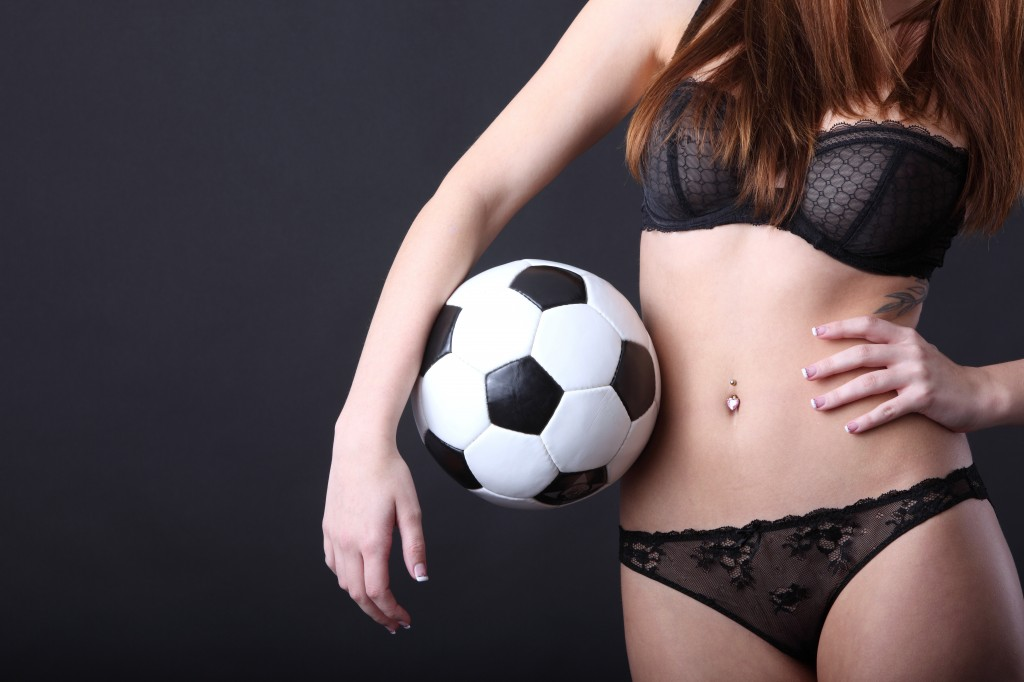 sexy woman in lingerie with classic soccer ball