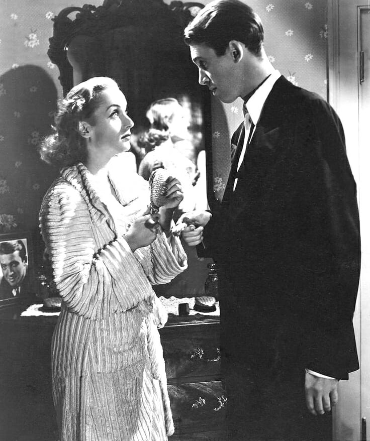 Carole Lombard, wearing a chenille robe, and Jimmy Stewart in Made for Each Other, 1939
