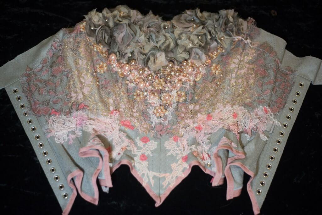 Neon Duchess' signature pearl beads transform the bust ruffles into a textural heart motif.