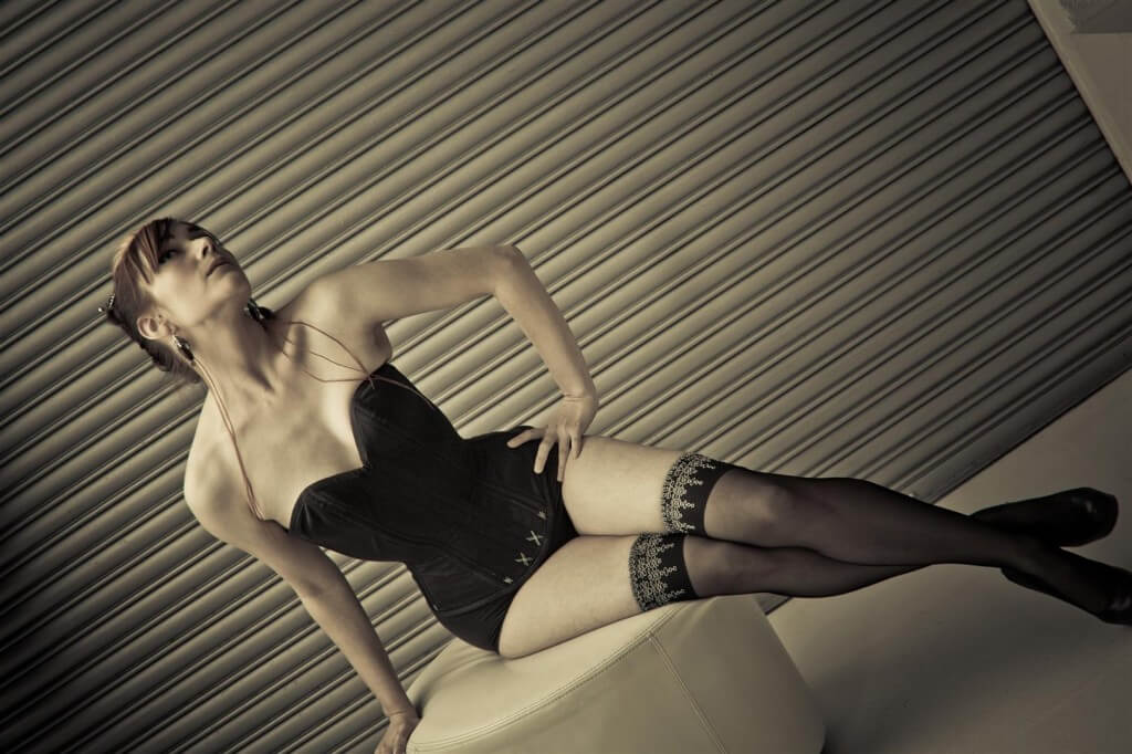 """Many people find this cupped rib shape to be more """"extreme"""" looking and assume it's uncomfortable, but it actually compresses the ribcage as minimally as possible.  Corset: Pop Antique, Model: Victoria Dagger, Photo: Karolina Marek"""