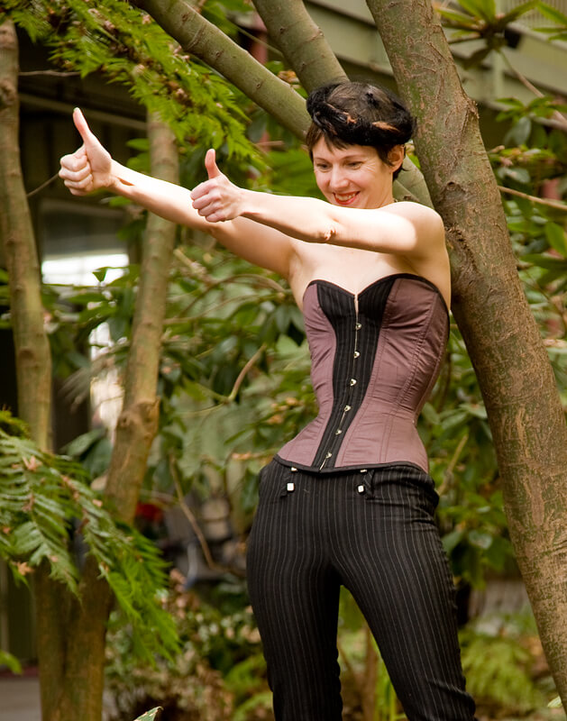A client, Mariah Carle (of Carle Photography) hangs out comfortably in her Pop Antique corset.
