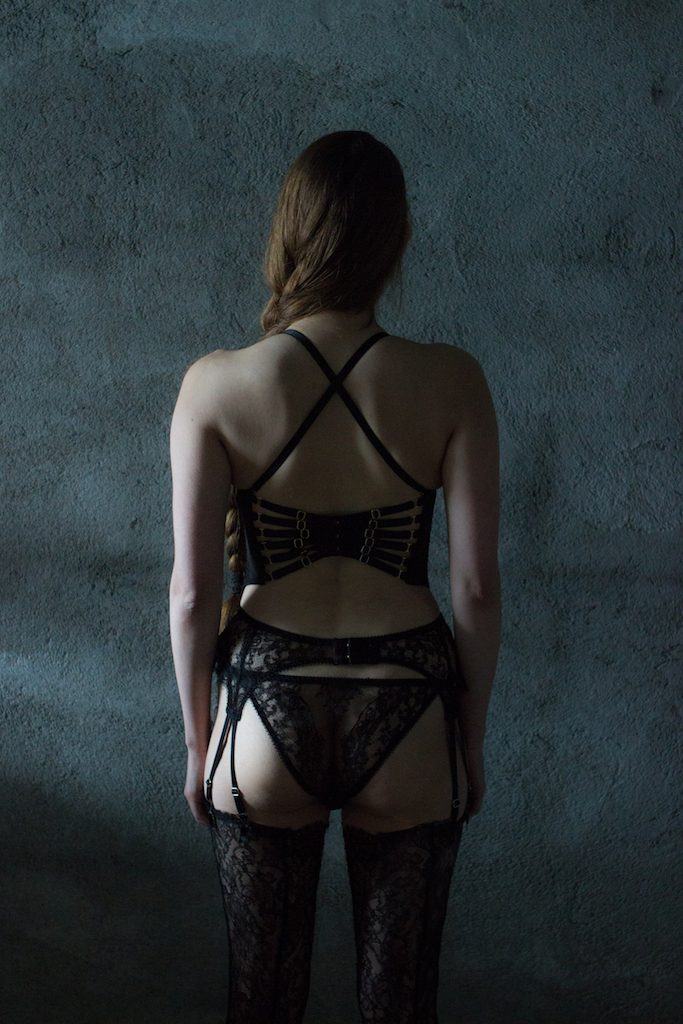 Karolina Laskowska 2017 'Taakeferd' Collection. Strappy back bra, knicker, garter belt, and stockings - all in black lace.
