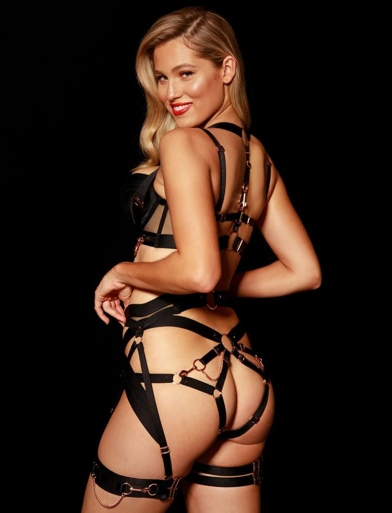 Honey Birdette Kukuro Set. Back view of strappy black lingerie.