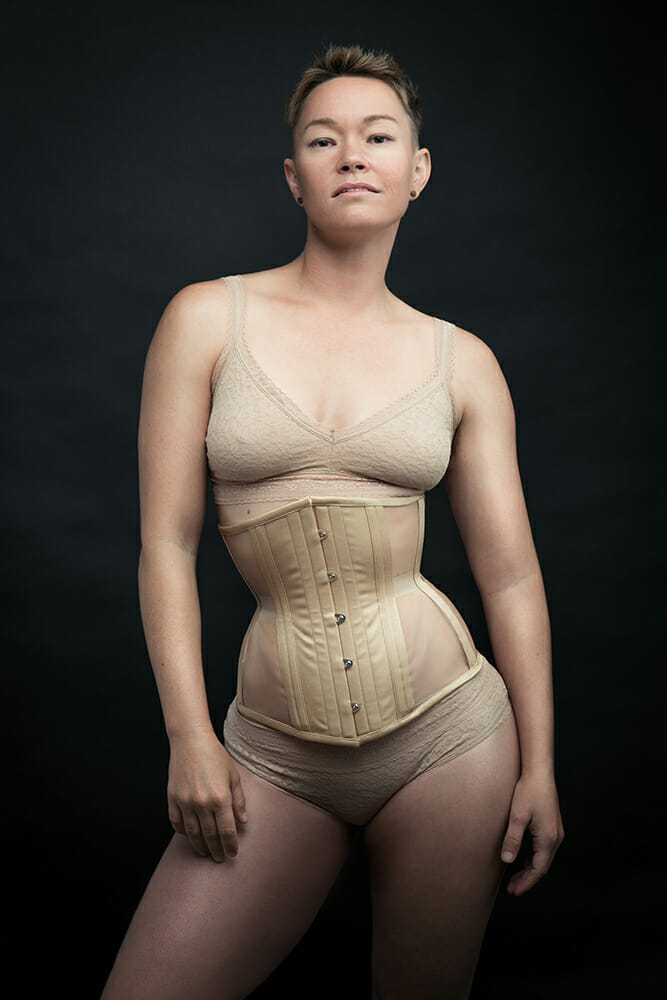 Dark Garden Corsetry campaign featuring queer porn performer Jiz Lee