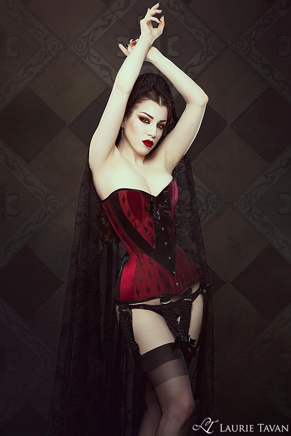 Laurie Tavan red and black diamond motif overbust corset | Model: Threnody in Velvet | Photo © Iberian Black Arts