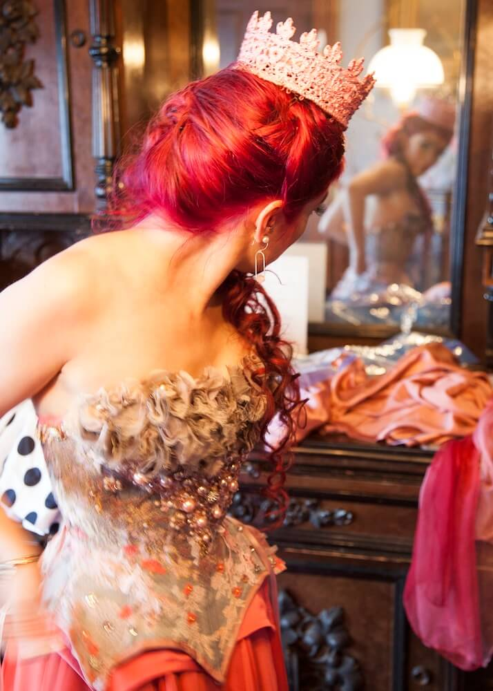 Lacing myself into my corset for my wedding reception. | Photo © Gaede-Glass Photography