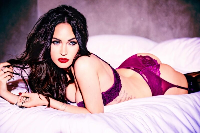 Megan Fox by Ellen Von Unwerth for Frederick's of Hollywood. Model wearing purple lingerie on the bed.
