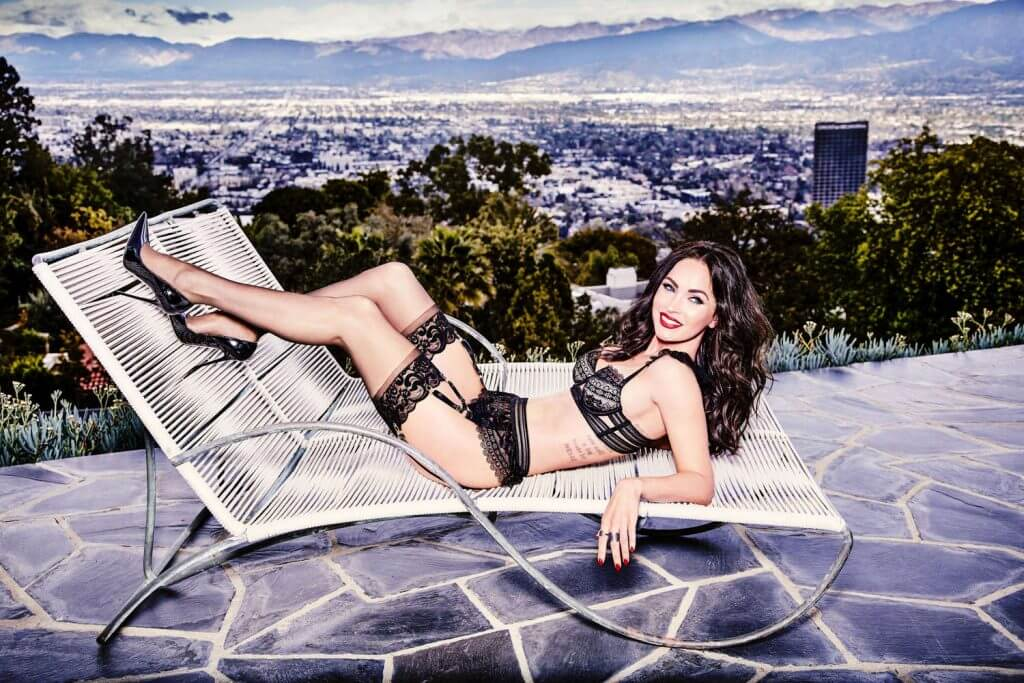 Megan Fox by Ellen Von Unwerth for Frederick's of Hollywood. Model in a black lace lingerie set and stockings overlooking Hollywood.