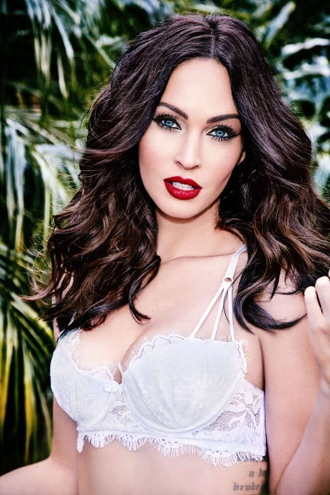 Megan Fox by Ellen Von Unwerth for Frederick's of Hollywood. White lace bra and red lips.