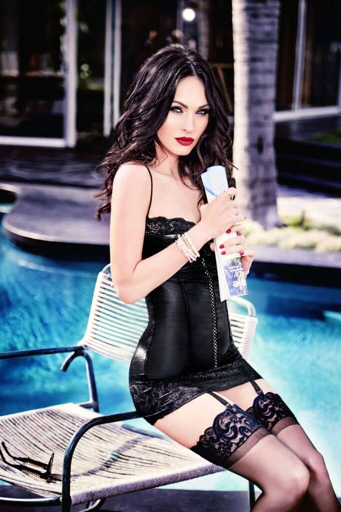Megan Fox by Ellen Von Unwerth for Frederick's of Hollywood. Poolside model with strong makeup in black lingerie and stockings.