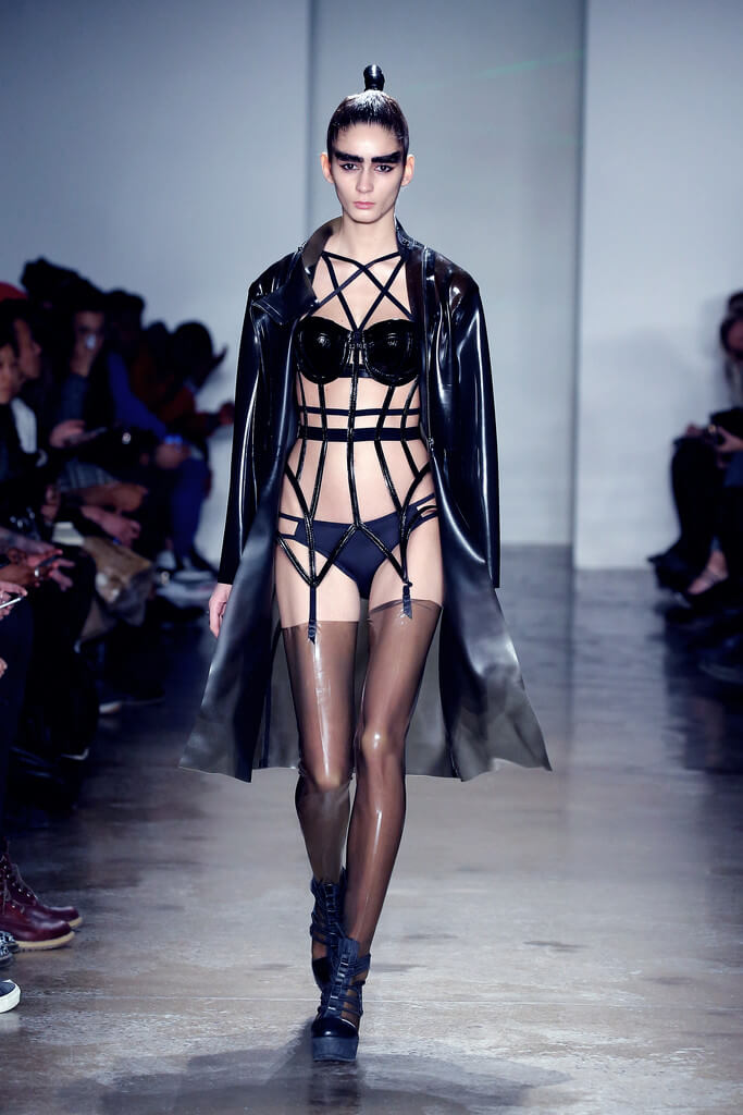 Masculine leather and eyebrows with stockings and garters: is this androgynous? Via Chromat.