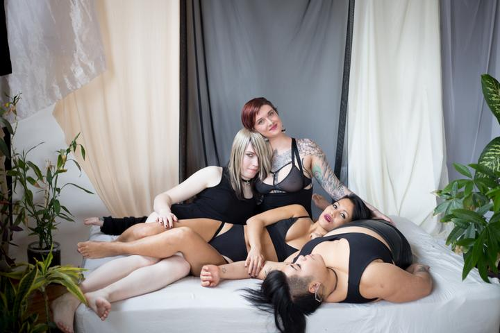 The team at Origami Customs, a queer-owned lingerie company specializing in intimate apparel for other queer people.