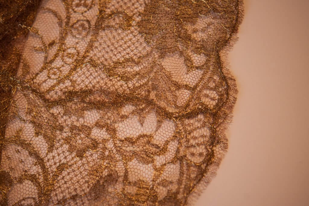 Lace seaming detail on Rosamosario's silk palazzo pants.