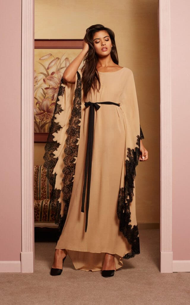 Rosamosario. Lingerie Trends - Luxury Loungewear. Silk caftan style robe in toffee with black lace trim.