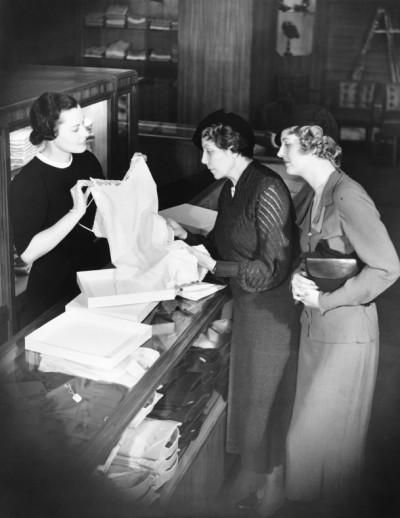 Sales Clerk Presenting Lingerie