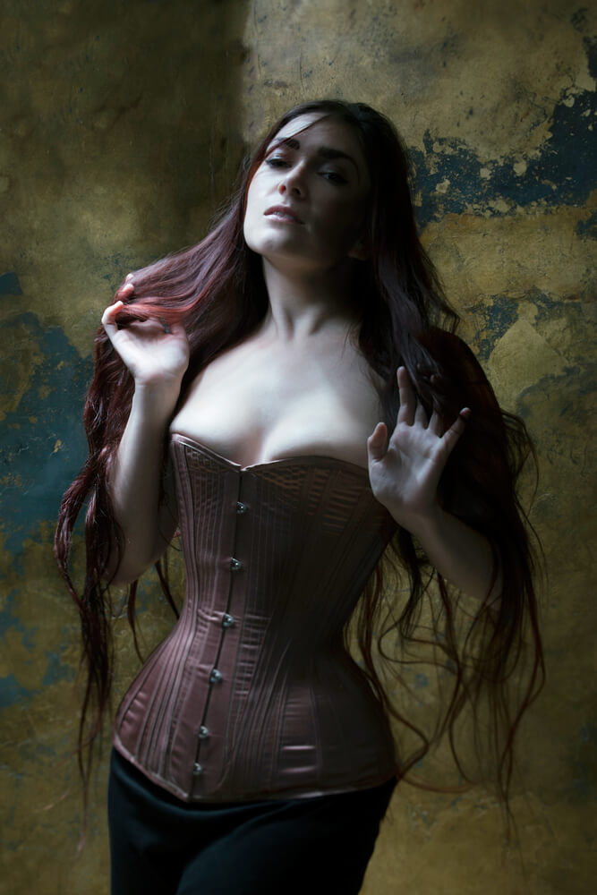 "Sparklewren ""Rose Gold"" corset with conical rib. Model: Victoria Dagger. Photo © Sparklewren."