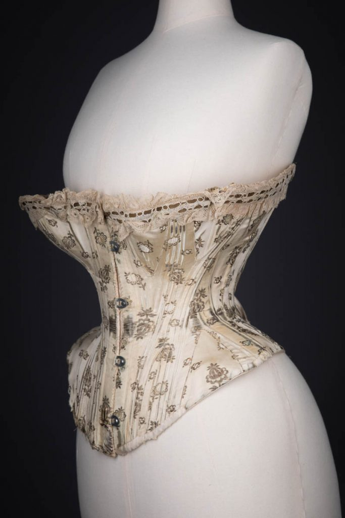 Metal & Silk Brocade Corset With Ribbonslot Lace Trim, c. 1900s. From The Underpinnings Museum collection, photography by Tigz Rice.