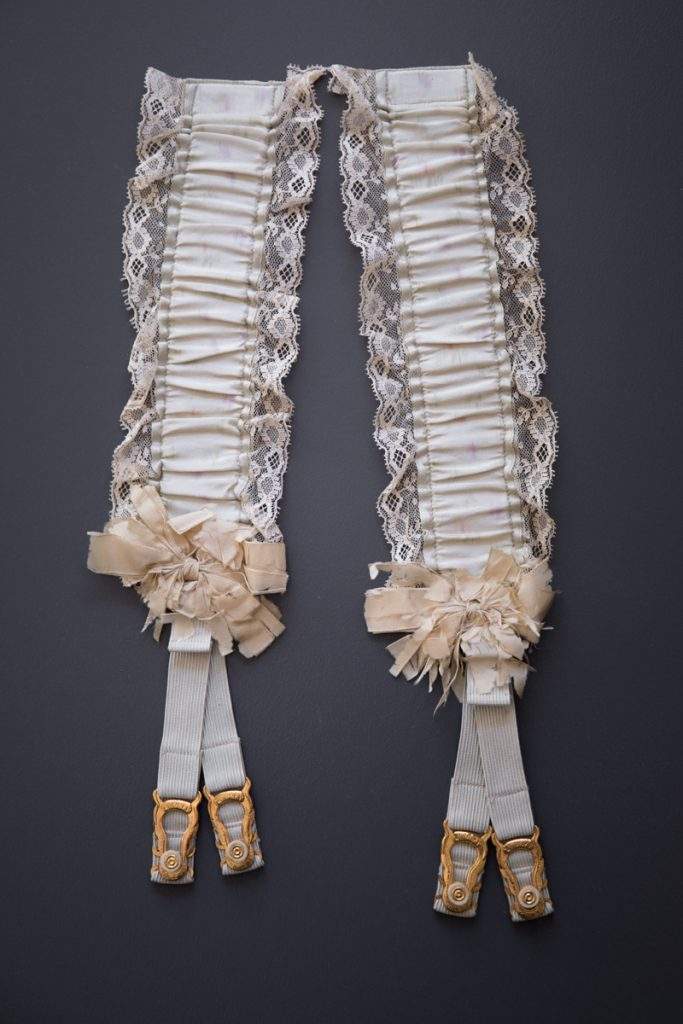 Silk hose supporters, c. 1890s, USA. These would have originally been pinned to a corset, with the straps reaching just above the knees. From The Underpinnings Museum collection. Photography by Tigz Rice