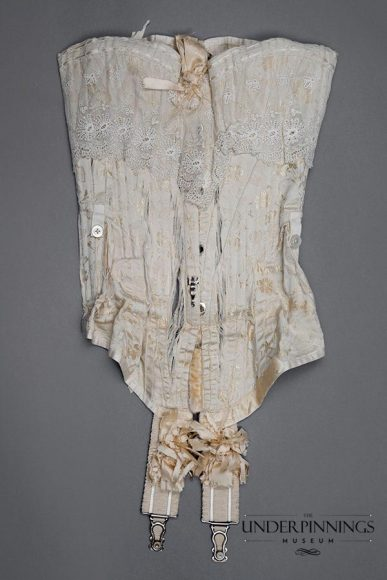 This Edwardian corset is exquisitely beautiful and wonderfully complex. The pattern for this garment is extremely challenging and this piece would have been quite restrictive to wear, compared to corsets from the previous century. From The Underpinnings Museum collection. Photo by Tigz Rice Studios