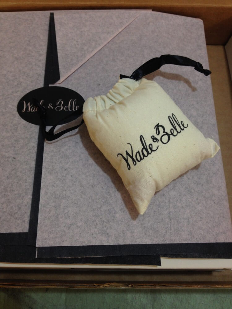 "Wade & Belle ""Not Too Tights"" packaging: tissue paper wrapped tights, branded sticker, branded perfume sachet, fitted perfectly into a compact shipping box."