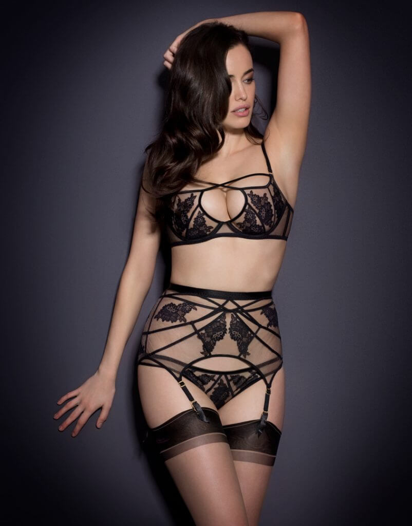 Agent Provocateur. Lingerie Trends - Lace Applique. Black tulle bra, knicker, and garter belt with black stockings.