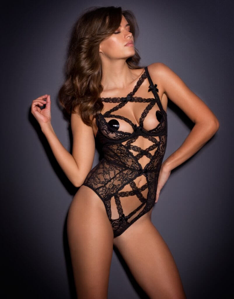 Agent Provocateur. Lingerie Trends - Strappy. Lace bodysuit with cutaway front and nippe pasties. Luxury lingerie.