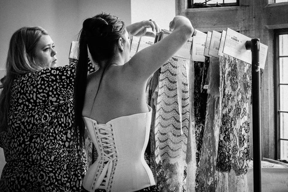 """""""Corset Fellows"""" of the Oxford Conference of Corsetry: Alison Campbell and Marianne Faulkner (me) sorting lace samples."""