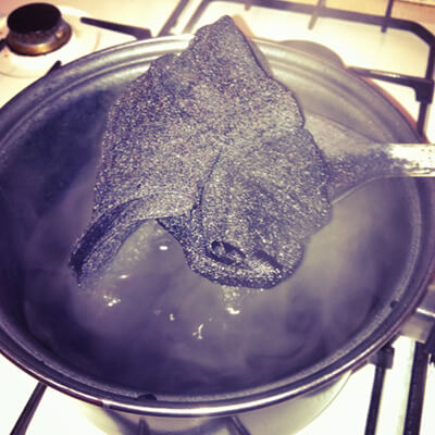 If you're using disperse dye you should do it on the stove to keep the water boiling. Otherwise the water will gradually cool down and the end result will be a lighter color.