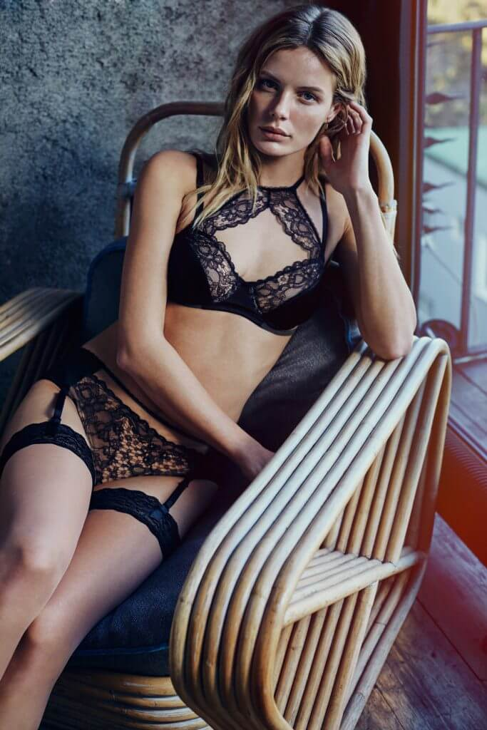 Else Lingerie. Lingerie Trends - High Necked Bras. Black silk bra and brief with lace trm. Sheer stockings.