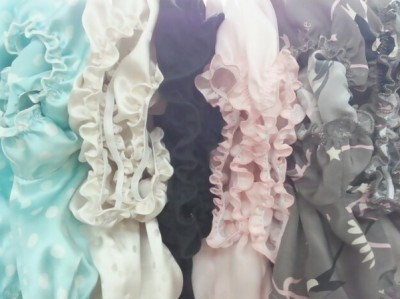 Silk tops by she and reverie hanging in their Manhattan factory