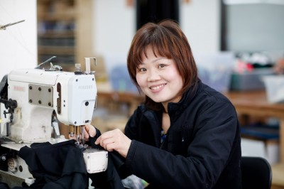 A garment worker at the Dear Kate factory in Queens, NY. Photo by Brister Photo.