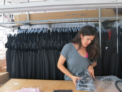 Laura from Lola Haze taking inventory of her new production run