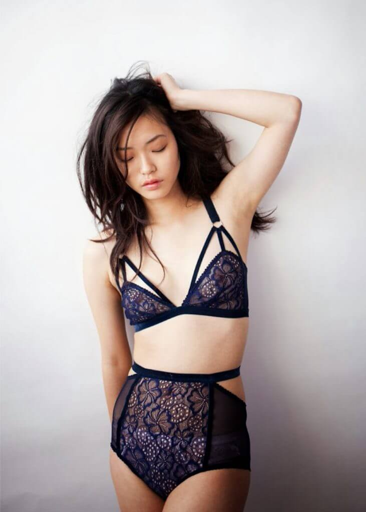 Lonely Lingerie. Lingerie Trends - Strappy. Navy blue lace bralette with matching high waist panties.