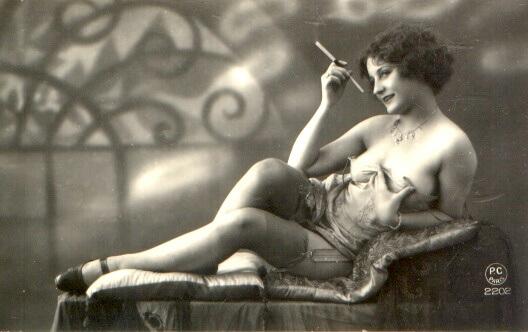 Vintage pinup with cigarette holder and beautiful stockings and garter belt.  Via VioletIvory on DeviantArt.
