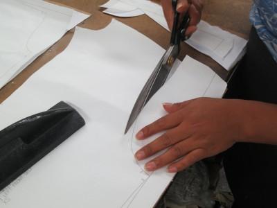 Cutting a sample garment