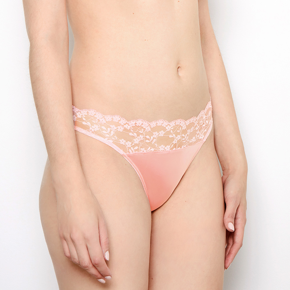 Lower body shot of model wearing Sophia, blush pink, vintage knickers. Sheer, French, floral-embroidered tulle detailing across waistband.